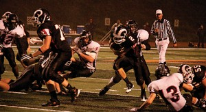 Ryan Darby (#2) rushes hard to get a Rockford first down.	Photo by TOM SCOTT