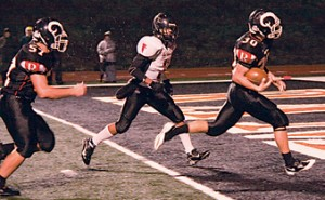 Nick Smythe (#30) scores Rockford's third touchdown, which puts the Rams ahead.	Photo by TOM SCOTT