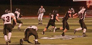 Joe Johnson (#3) breaks loose for a big gain and the setup for a touchdown.Photo by TOM SCOTT
