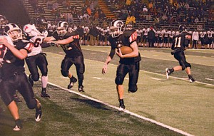 Ryan Darby (#2) sets up yardage for a Rams touchdown.Photo by TOM SCOTT