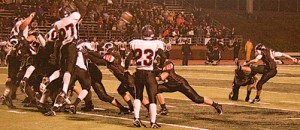 Paul Mudgett (#41) kicks a perfect field goal for the extra point.Photo by TOM SCOTT