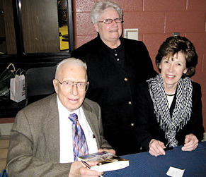 """SIGN HERE—A beaming Rockford Mayor Janice """"Chi Chi"""" Rogers (center) has just had her book autographed by Fred Meijer. Pam Kleibusch (right) has been Fred's personal assistant for 52 years. Coincidentally, Rogers has been an official greeter and event coordinator for the Rockford Meijer since the day it opened."""