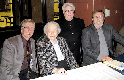 WRITERS OF NOTE—Not in the least bit shy about networking, Mayor Rogers stands with book authors Bill Smith (left) and Larry ten Harmsel (right) along with Lena Meijer (center, where Fred said she belongs).