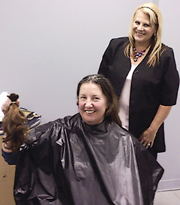 CUT FOR A CAUSE—Dawn Roberts of Hair Taylors cuts and styles the hair of Barb Waskelis of Rockford. Waskelis donated her hair to Locks for Love.