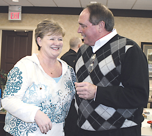 WISHING WELL—Sam Russell is thanked for her many years of service by Rockford's Police Chief Dave Jones.