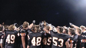 The Rockford Rams hoist the district trophy.	Photo by TONY ANDERSON