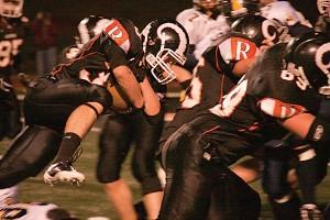 Nick Smythe (#30) breaks through for a touchdown setup.Photo by TOM SCOTT