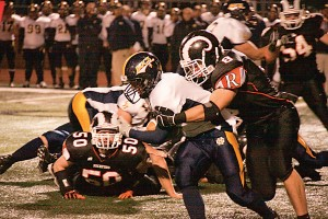 Joe Stefanski (#8) halts the Bucs' running game.	Photo by TOM SCOTT