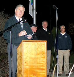 Plainfield Township Supervisor George Meek speaks during a ceremony at the Belmont veterans memorial on Veterans Day, Wednesday, Nov.11. Behind him are State Representative Vern Ehlers, Representive Tom Pearce and Senator Mark Jensen.