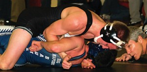 Austin Scogg goes for the pin.