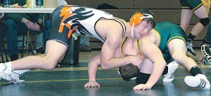 Paul Creighton struggles for a take-down in his win against Comstock Park's Tyler Reading.