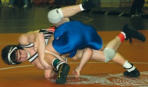 Jake Byers attempts to spladle Nick Trimble in the finals of the Kent County Classic.
