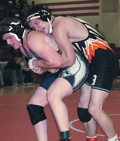 """""""The Mighty Joe"""" Stefanski keeps his opponent off balance to finish with a 4-2 decision over Drake Renas of B ig Rapids."""