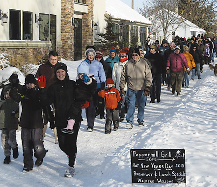 The vanguard of a throng of walkers heads south our of Rockford on the eighth annual Friends of the White Pine Trail New Year's morning Resolution Walk.Photo by CLIFF HILL