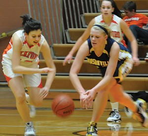 Lady Ram sophomore Halle Peterson steals the ball from Hudsonville's Hanna Stone.
