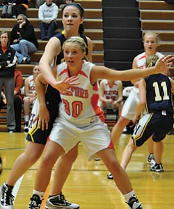 Rockford senior Caitlyn Patterson posts up strong in the lane.