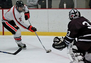 Geoff Garman takes a shot on goal for the Rams.Photo by MICHELE VANDERVELDE