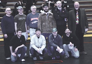 Rockford celebrates the 1997 state runners-up at the West Ottawa dual meet Wednesday, Jan. 13.	Photo by JIM COOPER