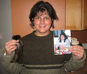 Beth O'Donnell holds a photo of her sister Barbara Liggins after cutting her hair to donate to Children with Hair Loss.