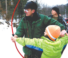 Bill Skallos teaching archery to a youngster at the Ikes Winterfest this year.