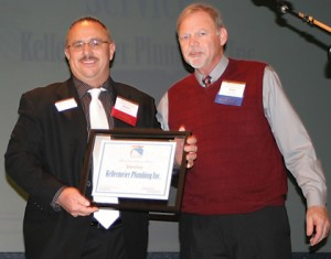 Last year's winner of the Service Award, Action Tax and Money Concepts' Jerry Coon hands out this year's award to Blaine Kellermeier of Kellermeier Plumbing, Inc.