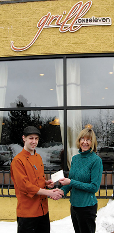 Matt Lenkiewicz presents contest winner Leta Halloway with a $50 gift certificate to the fine Rockford eatery.
