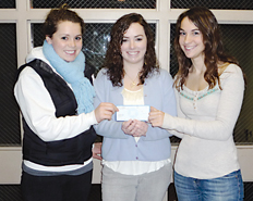 Youth Initiative members (l–r) Ashley Gremel, Shelby Denhof and Mackenzie Young show off the check from the Rockford Education Association.