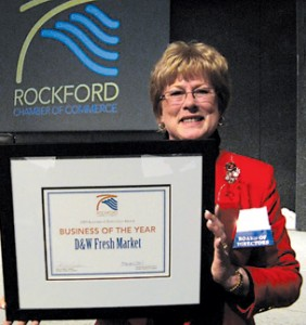 Char Bouwkamp  receives the evening's top award, Business of the Year, for D&W Fresh Market, for the company's long standing in Rockford and generous support of community events.