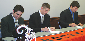 Paul Mudget, Taylor Masiewicz and Joe Stefanski sign letters of intent to play football for the school of their choice.