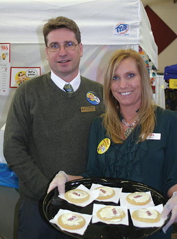 Ric's Food Center Store Director Dave Brickner helps pass out samples during Expo. A variety of treats were given out.