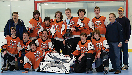 Celebrating a championship win after five overtime periods is the 2010 Rockford inline hockey orange team of (front row, l–r) Cory Ball, Andrew Wenger, E. Zeigler, Ty Schwandt, T. Woods, A. Bloss; (back) Coach Trimble, C. Karrip, Adam Shiffman, Steve Jaeger, David Schaller, C. Parrish, A. Leverett, Coach Wenger, and Coach Zeigler.