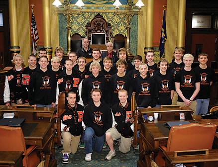 State Rep. Tom Pearce (back, right) stands with the state champion Rockford Rams water polo team, who won their sixth title in seven years.