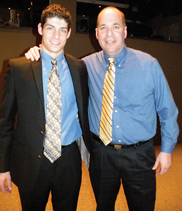Conor Thelan and Coach Dave McWatters pose together at the annual Rockford Water Polo Banquet.