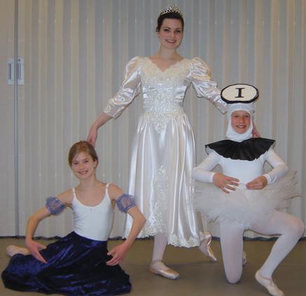 Lauren Hyink, Kathleen Bomer, and Katerina Rozelle in costume.