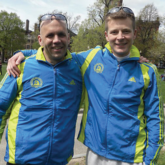 Rockford friends and co-workers Robert Rinck and Josh Miller still smiling after finishing the Boston Marathon.