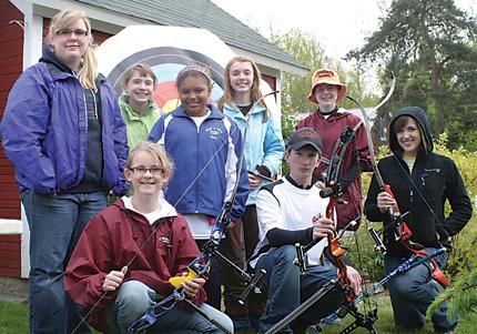 SHARP SHOOTERS—Stars of the Rockford Junior Olympic Archery program include (front) Alice Billin, Tyler Glenn and Raija McIntyer and (back) Mikaela, Corinne Giersch, Mikayla Venoms, Hayley Giersch and Katerina.