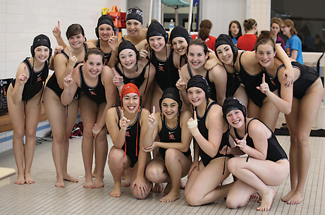 Rockford's junior varsity girls water polo team celebrates their victory over 13 other teams in the Michigan Water Polo Junior Varsity State Championship tournament.            Photo by KANDI JEZAK