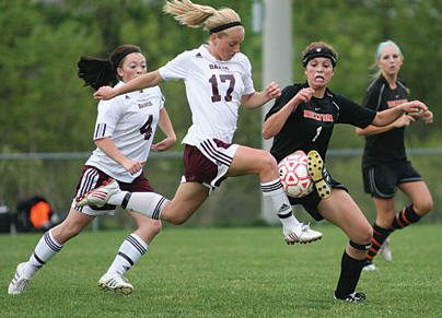 "by JACKIE HOLLAND-DECKER  	Missed opportunities have plagued the Rockford girls soccer team all season long. Many times they have outplayed their opponents, only to lose in the last few minutes of the contest. When they found themselves trailing host Grandville 2-0 in the OK Red conference tournament opener Thursday night, May 20, at Grand View Elementary School, they had a decision to make:  Let the Bulldogs have the victory, or find it within themselves to pull together and win. They chose the latter, erasing the 2-0 halftime deficit to win 3-2. 	""The biggest thing is what we proved to ourselves,"" said Coach Amira Ponne. ""We can come from two goals down and score three goals to win. The girls trusted us in the decisions we made. They believed it and it worked."" 	In an effort to jumpstart the comeback, the coaches s"
