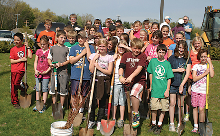 Valley Views Green Team plants 40 red maples as the city's last step to be a Tree City USA.