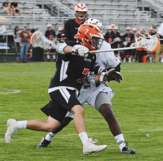 Attack man  Mitchell Newton is shown in action against U-D Jesuit. Photo by MURRAY SPORTS PHOTOGRAPHY