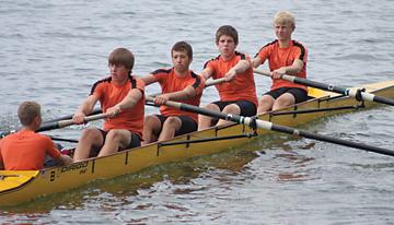 The men's novice four boat  of (l–r) coxswain Joe Nemeth, Jacob Kaiser, Tyler Perkins, Corey Fase and Tristan VanFossen takes second place at the Culver Regatta.