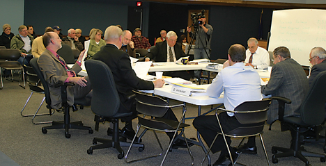 The Plainfield Township Board and manager work out details of a new budget earlier this year. Two trustees and the Su