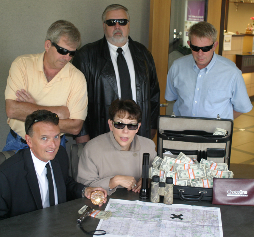 A thousand bucks is serious money, and this year's treasure hunt organizers are serious about giving it away. Three clues a week will be offered instead of the two clues as in past years. Pictured are the Cannon Area Business Association members who organize the treasure hunt in Cannon Township worth $1,000 to the first to find the copper coi