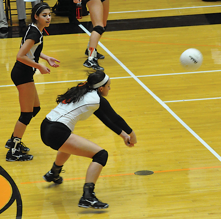 Ram senior defensive specialist Heather Gates makes a pass in Rockford's win over East Kentwood.