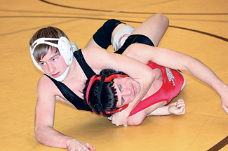 Tyler VanRooyen runs a turk on his opponent from Bedford. Photo by JIM COOPER