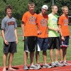 Accepting top finisher awards at the Rockford invitational are Mark Lehman, Austin Benoit, Drew Wosnick,