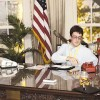 """Alex Quinn makes a """"red"""" phone call at President Reagan's desk in the"""