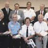 FIRST RESPONDERS RECEIVE GRANTS—These fire and police chiefs and representatives of local rescue or