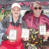 "Chili Cook-off contestants (l–r) Tom Troyanowski and Bill McDaniel take home three awards, cooking as ""The Two Bad Dads."""