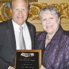 State Rep. Peter MacGregor accepts his award from Kathy Pelleran, state